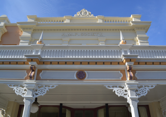 Rebuilt verandah with ornate woodwork & colours reinstated